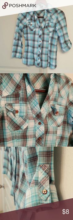 TOP SALE! 2/$12: Plaid Roll Sleeve Top Teal & Brown compliment each other well on this feminine plaid button up. A v-neck, with two front pockets, sleeves roll and button at about elbow level, stitching compliments the feminine shape. Passport Tops