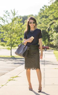 woven necklace, navy silk top, olive green lace pencil skirt, gray tote, gray suede pumps