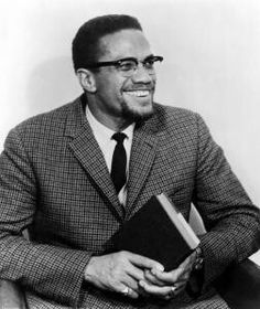 Malcolm X Scariest thing here...A black man who knows who he is...with a book!