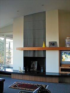 Floor to Ceiling Brushed Aluminum Custom Fireplace Surround The