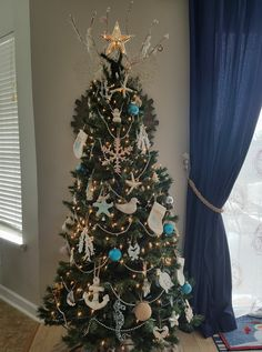 A collection of coastal, nautical and beach themed Christmas trees....