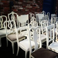 If we bought her a few more chairs for her kitchen table we could paint them all one neutral color for cohesion.