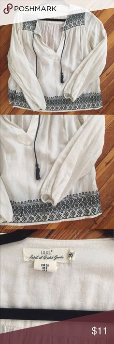 Flowy summer shirt Perfect condition, never worn Size 38 which is a womens 8, medium blue crocheting/stitching, white fabric originally $49 from the H&M conscious line. send me an offer:) H&M Tops Blouses