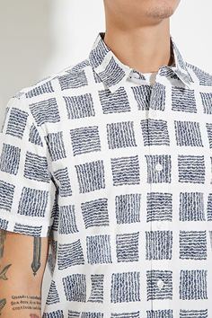 This classic woven shirt is complete with a buttoned front, basic collar, short…