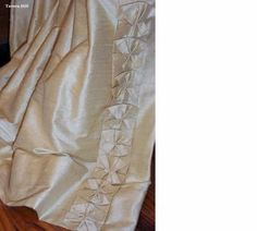 Drapery panel with a box pleat accent down leading edge