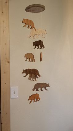 This mobile is made with 9 wooden bears. Each bear measures about 4 . The bears are stained in 3 different colors and all have a coat of varnish.