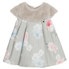 Younger girls grey floral dress with fur collar by Lapin House. The fabric has a soft, brushed feel, with a lovely herringbone and rose print in pale blue and pink. There is an attached grey, plush fur collar and a back zip fastening and cotton lining.