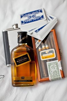 Groomsmen Gifts: Flask and mini liquor bottle, cigars, cards.