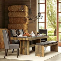 Rustic dinning room. Comfy chairs to linger in after dinner. Minus hay stacks - critters might make a home in there!