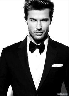 Suit & bow-tie.