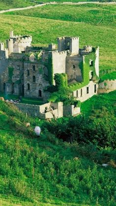 Clifden Castle is a ruined manor house west of the town of Clifden in the Connemara region of County Galway, Ireland. It was built circa 1818 for John D'Arcy, the local landowner, in the Gothic Revival style. Oh The Places You'll Go, Places To Travel, Places To Visit, Beautiful Castles, Beautiful Places, Dream Vacations, Vacation Spots, Photo Chateau, Ireland Travel
