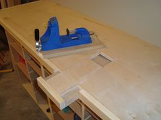 """Kreg jig """"in your bench-top"""" jig. Slick idea with a replaceable section in your work bench."""