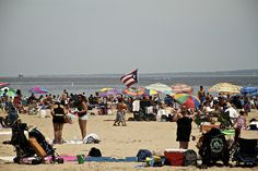 The Bronx Riviera (aka Orchard Beach) by charles le brigand, via Flickr