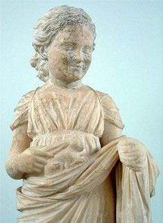 Girl holding rabbit, one of many sculptures left at Brauronia as votive offerings to Artemis