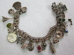 Vintage Elco Sterling  Charm Bracelet with Many Charms by COBAYLEY, $150.00