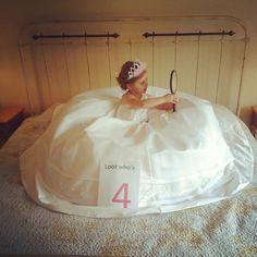 My daughter In my wedding dress, on my moms bed, looking in my grandmas mirror. Little girls. Princesses. Mommy's wedding dress.
