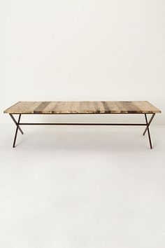 Modern lines, weathered wood, can vacuum under it--great for my living room!  Plank House Coffee Table #anthropologie