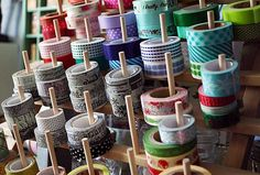 Washi tapes on large spool (sewing thread?) organizer.  Possibilities for rings, bracelets?