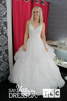 Wow! Frills, lace, beaded straps and a tiered skirt make this dress fit for a princess. Would you say yes to the dress?