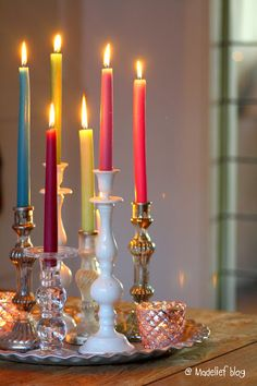 Taper Candle Arrangement ~ Using different color tapers and holders creates an interesting look.