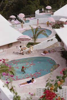 Las Brisas Hotel (© Slim Aarons 1968) Las Brisas looks exactly the same now as it does in this picture, only now you get a pink striped jeep to drive to your bungalow! Well, I don't because I can't drive a 5 speed.
