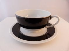 contemporary porcelain cup and saucer set by hennie's deli | notonthehighstreet.com