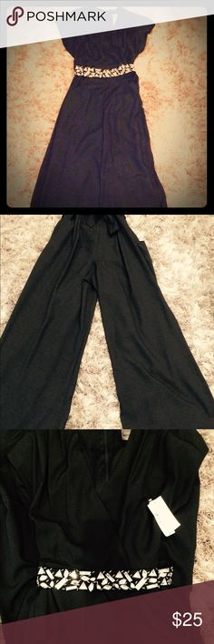 NWT Black wide leg sleeveless jumpsuit Sexy NWT sleeveless black jumpsuit. Lightweight material. Comes with jeweled belt. Wide leg. Bisou Bisou Pants Jumpsuits & Rompers