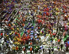 Costly Crowd by Andreas Gursky this photo shows disorder in people, but yet order in the pattern of people.