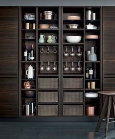 Varenna_The open tall unit is available in three heights  and is distinguished by subtle details, like the glass holders and the wicker baskets that introduce the idea of the custom made furniture in the collection Varenna.