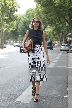 Fashion Blogger Candela Novembre wears a Marni top, Jil Sander skirt and shoes and Spektre sunglasses on day 1 of Paris Fashion Week Haute Couture Autumn/Winter 2015 on July 5, 2015 in Paris, France.