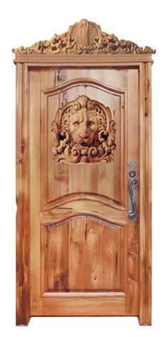 Lion Head - Carved Wood.  I wonder where this door leads.