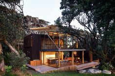 New Zealander pohutukawa tree meets the Finnish birch! The Octo 4240 birch pendants by Secto Design look amazing in this beautiful modern wooden house by Herbst Architects is located in Pohutukawa, New Zealand. Cozy Modern House Of Natural Wood Architecture Design, New Zealand Architecture, Architecture Interiors, Residential Architecture, House In The Woods, My House, Eco Construction, Haus Am Hang, Modern Wooden House