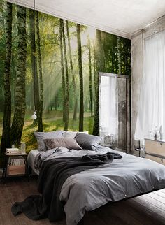 Let the sun in on your room with a peaceful forest wallpaper to brighten up each day. The lush green hues and soft yellow sunlight shining through this wallpaper mural can transform any room into a calming getaway. Pairs perfectly with wood decor accents and neutral tones. Location: Aubergine Studios