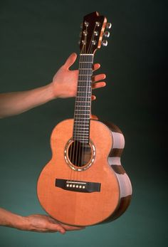 Small guitar probably using a tenor uke scale by Linda Manzer. Small Guitar, Cool Guitar, Archtop Guitar, Bass Guitars, Acoustic Guitars, Making Musical Instruments, Music Instruments, Bagdad, Guitar Collection