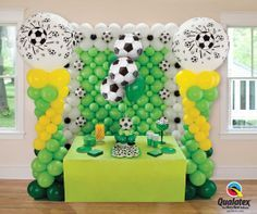 Are you ready to party for the World Cup? Here is some inspiration for your decor: column topped with 3 ft balloons, a wall with Microfoil soccer ball balloon accents and a bouquet for the dessert table. Of course we would use purple and gold. Balloon Columns, Balloon Wall, Balloon Arch, Balloon Bouquet, Soccer Birthday Parties, Soccer Party, Soccer Ball, Soccer Centerpieces, Football Party Supplies