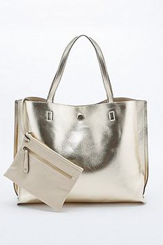 fed86e401377 Reversible Vegan Leather Oversized Tote Bag in Ivory and Gold - Urban Outfitters  Vegan Leather
