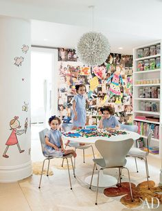 In her Manhattan duplex, designed by David Mann of MR Architecture + Design, magazine editor Darcy Miller Nussbaum created a whimsical mural, at left, for her daughters' playroom. Streamlined furnishings are paired with a floor-to-ceiling collage of family photos, and a rug custom made by Judy Ross Textiles. (February 2012)