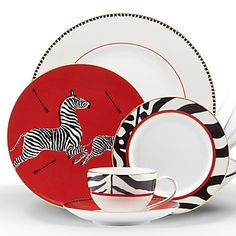 Scalamandre Zebras 5-piece Place Setting.  This is an interesting set... it has possibilities for mix & match.  I would like to be able to buy just the dessert/salad plates with the black & white rim.