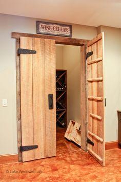 rustic wine cellar doors from reclaimed wood Repurposed History Home on Lake Wedowee