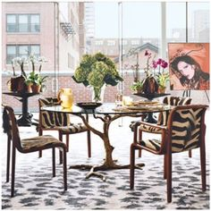 Mixing animal prints - Leopard print rug, with zebra print chairs and a tree trunk inspired table.