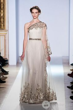 Zuhair Murad Spring Summer Couture 2013; Looks like a Greek Goddess, high wasted, flowing white dress with pleats and draping and has some characteristics of an outer tunic. Description from pinterest.com. I searched for this on bing.com/images