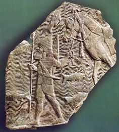 Relief depicting a cavalryman leading his horse beside a stream Assyria 704681 B.C.[600x666]