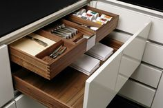 A place for everything... you have to appreciate the #walnut finish of these drawers made by #zeyko | #kitchenorganization #kitchenstorage