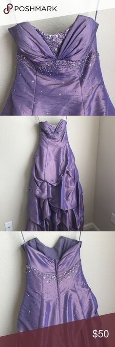 Mori Lee iridescent strapless purple prom dress Mori Lee iridescent strapless purple prom dress **TAGS WERE CUT OUT DURING ALTERATIONS** was altered to a size 2 and hemmed for a 5'6 girl wearing heels. Mori Lee Dresses Strapless
