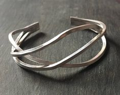 This statement cuff was handmade by me in my little workshop. The triple-band abstract design in this sterling silver modern design cuff will make it a timeless piece of jewellery. The modern design of this silver wire cuff means it can be worn by all ages and for every occasion. This