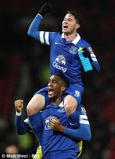 Bryan Oviedo and Sylvain Distin of Everton celebrating their win against Manchester United