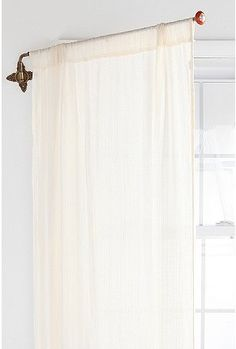 A cool idea... instead of puling curtains back, just flip it over to the other side, or create a screen.