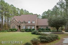 PRICE REDUCTION!!!  239 Farmington Rd.  Grimesland, NC 27837- New list price is $439,900.00!! Must see! European-inspired estate in quiet equestrian/river front community. Just under 3 acre wooded lot w/ circle drive. Shotcrete heated pool w/ built-in hot tub. Gourmet kitchen w/ lots of cabinets and all granite counter space. So much more than you can imagine!!