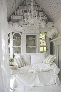 Inside is a chabby chic interior: The white wood floors and elaborate chandelier add oodles of style