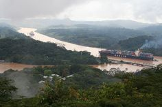The Panama Canal at Gamboa. It seems surreal to watch these gigantic ships sailing through the jungle. From atop a nearby hill, you get a true appreciation of the Herculean task it must have been to dig this canal through the rainforest. Here a container ship steams towards the Pacific Ocean.